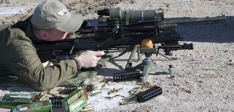 Sniper firing .308 ammunition at a shooting range