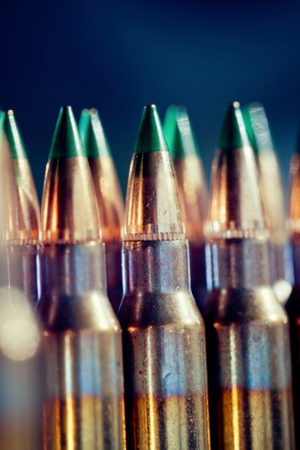 5.56 ammo with green tips lined up.