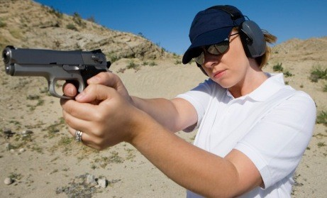 Woman with a handgun at a shooting range