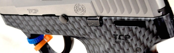Handgun with carbon fiber finish